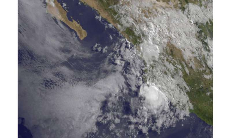 NASA shows a weaker compact tropical storm Carlos