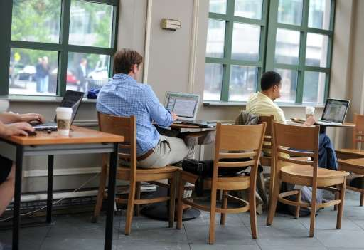 People use their laptop computers at a coffee shop in Washington, DC on May 9, 2012