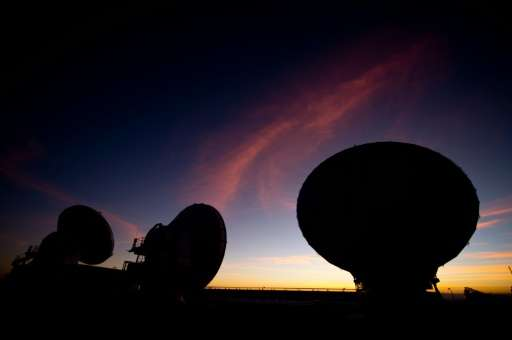 Radio telescope antennas of the ALMA project are seen in the Chajnantor plateau, Atacama desert on March 12, 2013