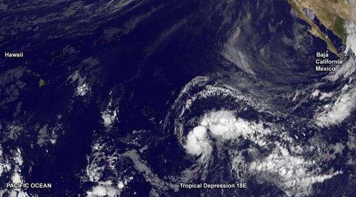 Satellite spots new depression exactly between Baja California and Hawaii