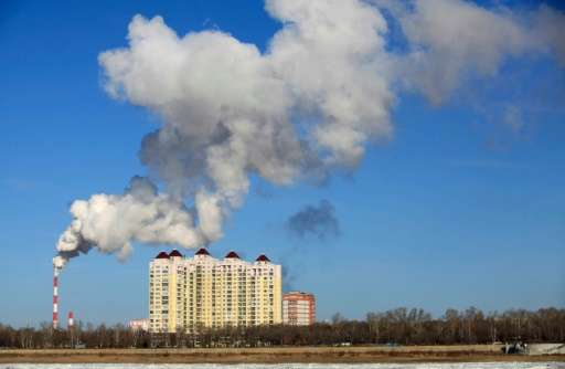 Smoke belches from a heating factory chimney in Heihe, in northeastern China's Heilongjiang province