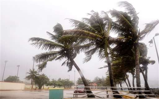 Typhoon pelts Guam with winds, rain; residents take shelter