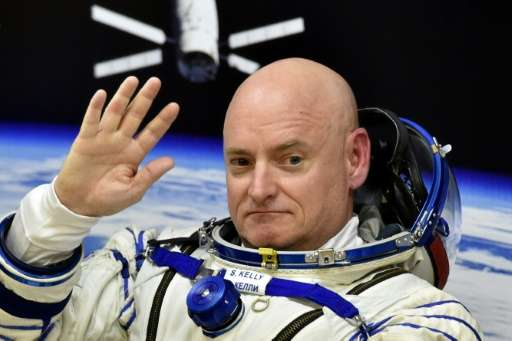US astronaut Scott Kelly waves prior to blasting off to the International Space Station, on March 27, 2015