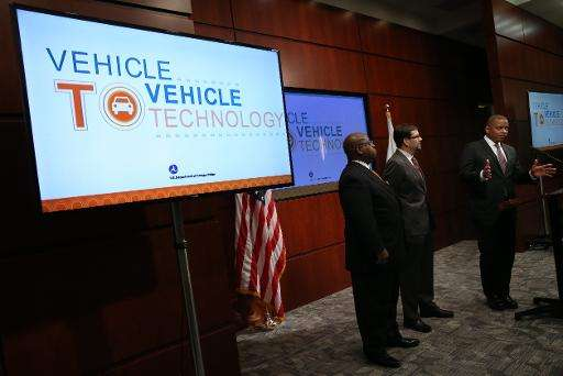 US Transportation Secretary Anthony Foxx (R) speaks during a news conference on automobile safety at the Department of Transport