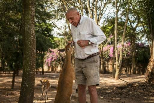 Willem Boulanger feeds an antelope in his small zoo in the back yard of his house in Kolwezi, in Democratic Republic of Congo's