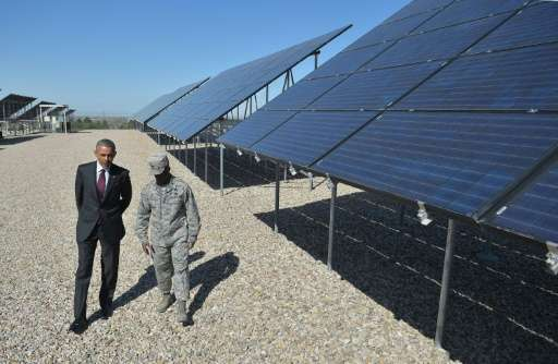 US President Barack Obama speaks with Commander Col Ronald Jolly as he tours a solar array at Hill Air Force Base in Utah