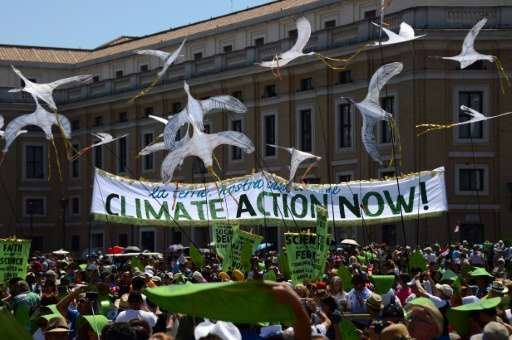 Environmental activists display a banner calling for action on climate change as they arrive on St. Peter's square prior to Pope