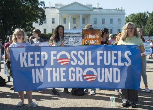 Environmental activists protest the Obama administration's plans to allow new fossil fuel drilling on public lands and oceans in