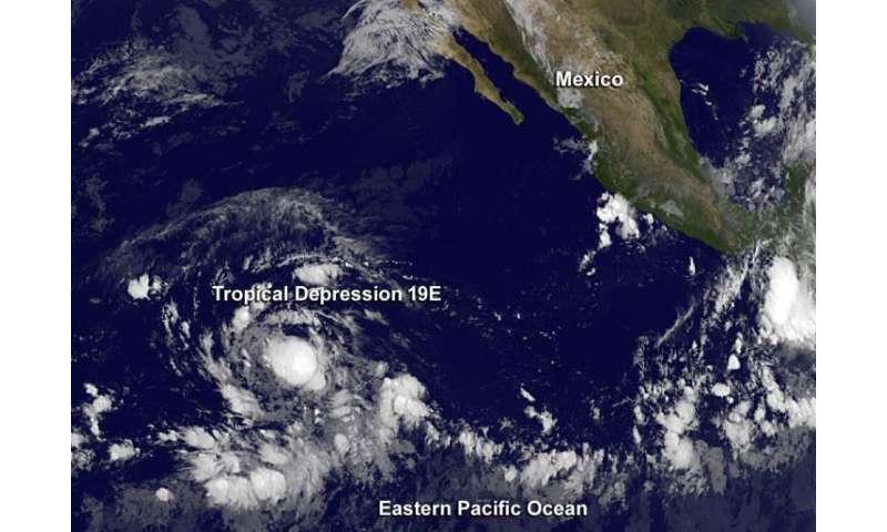 Satellite sees Tropical Depression 19E still disorganized