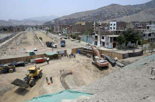 "Construction on a new road goes on in  the eastern outskirts of Lima, in the Andes, near the pre-Inca Puruchuco, ""Feathered"