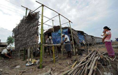 File picture shows a Myanmar family repairing their home in the aftermath of cyclone Nargis which smashed through the southern d