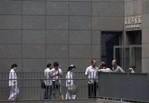In a nation of smokers, Beijing bans lighting up indoors (Update)