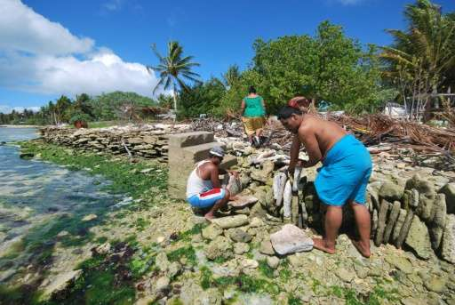 Inhabitants of Kiritimati atoll in the Pacific build a stone seawall to protect their homes as sea levels rise due to global war