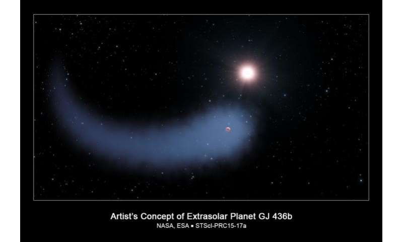 NASA's Hubble sees a 'behemoth' bleeding atmosphere around a warm exoplanet