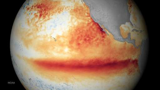 Satellite image of sea surface temperature measurements for October 2015, where orange-red colors are above normal temperatures