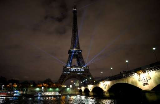 The Eiffel Tower lit up with green color and messages to prevent global warming during the first day of the United Nations clima