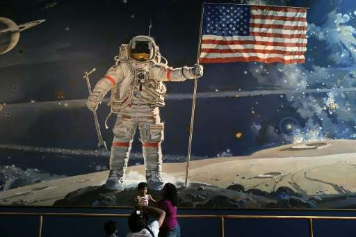 Visitors take photographs at the Smithsonian National Air and Space Museum in Washington, DC on August 31, 2012