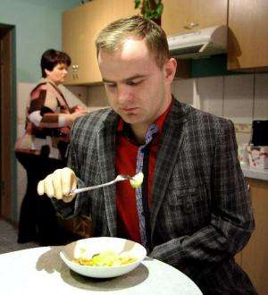 Martynas Girulis eats with his new bionic arm at his home in Pagegiai, Lithuania