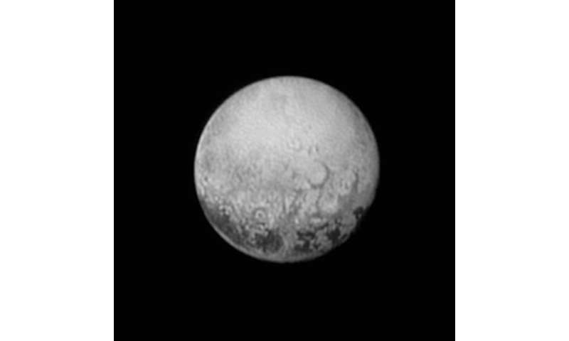 Spotlight shining on Pluto on cold outskirts of solar system