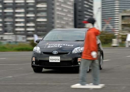 "This photo taken on October 10, 2013 shows Japanese auto giant Toyota Motor demonstrating its ""pre-collision system"" w"