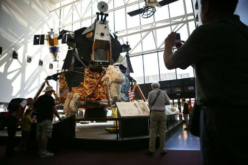 Visitors look at the exhibit of one of the 12 Apollo Lunar Modules that was built for the moon-landing program, August 31, 2012