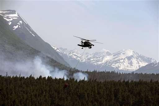 Western wildfires: Firefighters battle blazes in 4 states