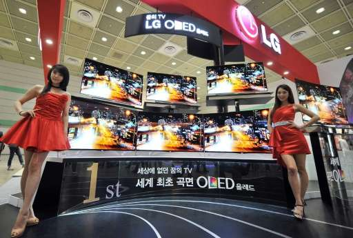 World's first curved OLED TV of LG Electronics are seen displayed during an IT show in Seoul in 2013