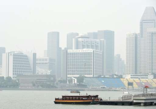 A general view shows buildings in the business district blanketed with haze in Singapore on September 8, 2015