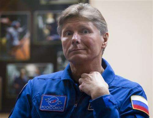 Astronauts board space station for 1-year mission (Update)