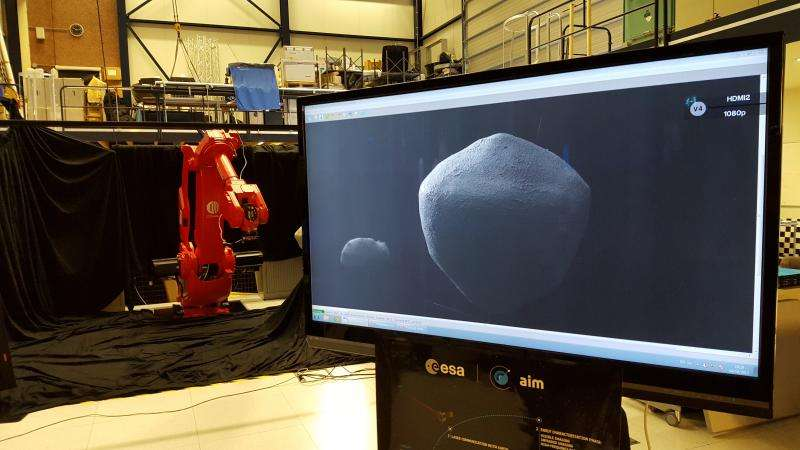 Image: Robotic arm testing AIM mission's camera