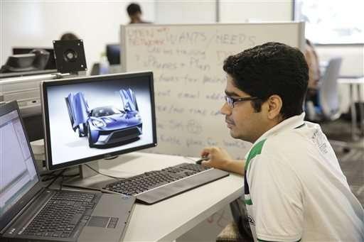 High-tech cars bring Detroit, Silicon Valley face to face