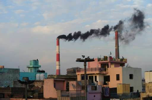 Smoke rises from the Badarpur Thermal Power Station in New Delhi