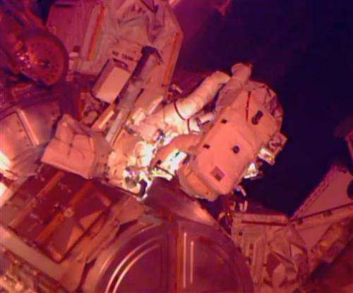Spacewalking astronauts finish extensive, tricky cable job