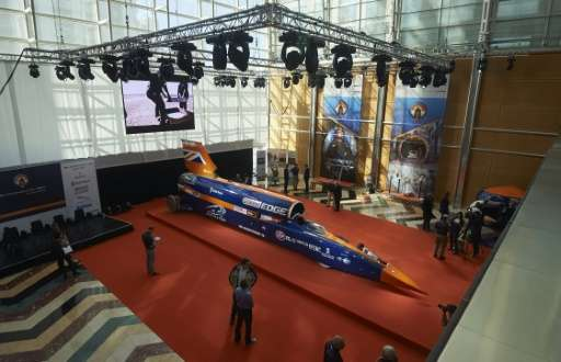 Visitors look at the Bloodhound Supersonic Car, a 135,000-horsepower car, at Canary Wharf in east London on September 24, 2015