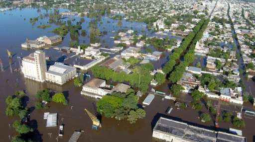 Aerial view of Paysandu harbor as Paraguay is hit by floods on December 27, 2015