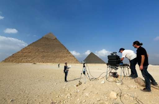 "A photo released by researchers on November 10, 2015 shows engineers from the ""ScanPyramids"" project using infrared th"