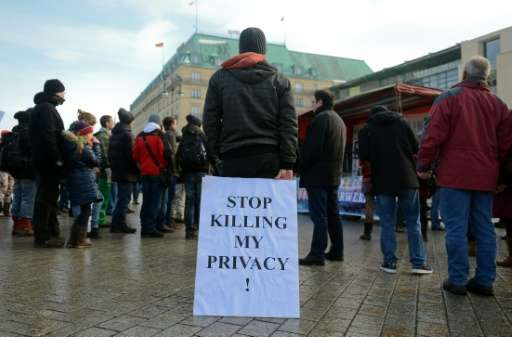 Demonstrators protests against data preservation in front of the US embassy in Berlin on February 1, 2014