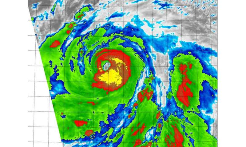 NASA's Terra Satellite sees powerful storms ring Typhoon Atsani's eye