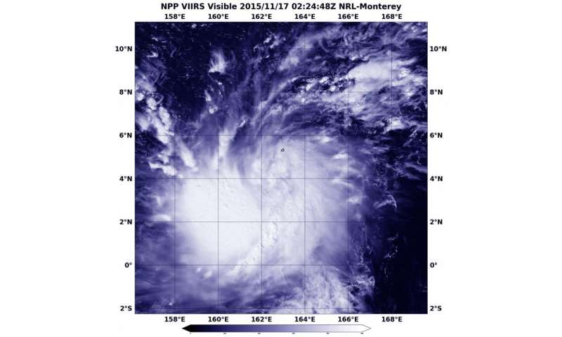 NASA sees tropical storm 27W form in Marianas Islands, warnings up