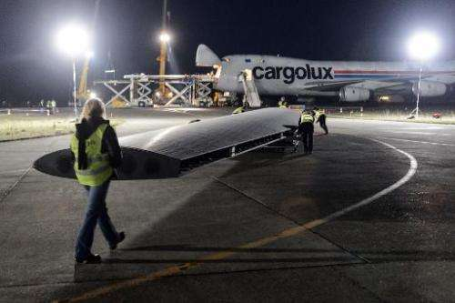 A 24m long wing element of sun-powered plane Solar Impulse 2 is loaded on a cargo aircraft on January 5, 2015, at Payerne airpor