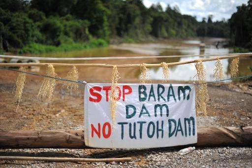 "A banner reading ""Stop Baram Dam"" is seen atn the main entrance to a blockade camp opposing the proposed dam on the Ba"
