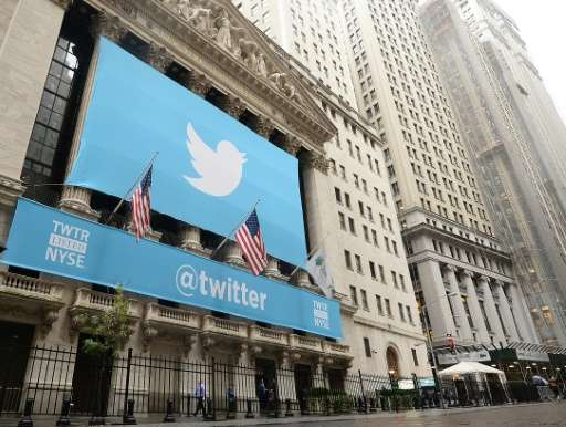 A banner with the Twitter logo on the front of the New York Stock Exchange on November 7, 2013