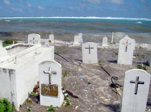 A cemetery on the shoreline in Majuro Atoll is flooded in 2008 by high tides and ocean surges in the low-lying Marshall Islands,