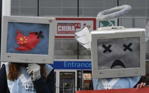Activists demonstrate for freedom of speech in China, during the CeBIT technology fair in Hanover, central Germany, on March 16,