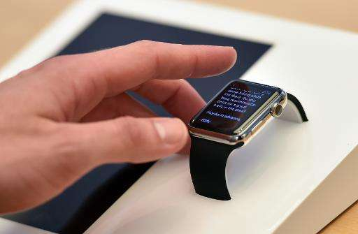 A customer tests a new Apple Watch in Sydney on April 10, 2015