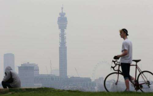A cyclist pictured at the top of Primrose Hill in London on April 3, 2014 as the city below lies shrouded in pollution