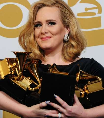 """Adele, photographed backstage at the 54th Grammy Awards with her six trophies, releases her new album """"25 on November 20, 2"""