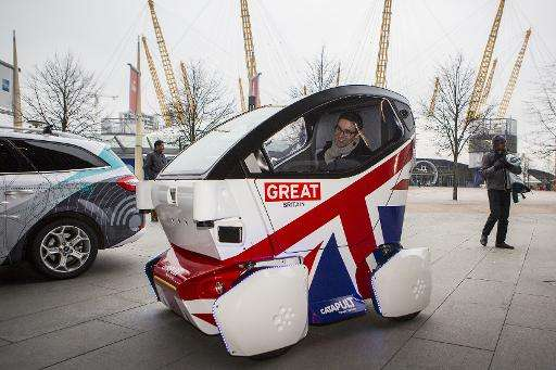A driverless vehicle known as a Lutz 'Pathfinder' Pod is pictured during a photocall in central London on February 11, 2015