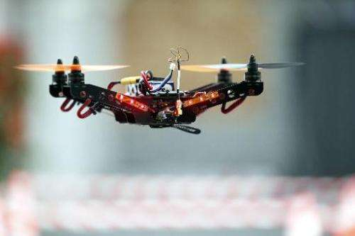 A drone flies at 'Drone-Days', the first fair on drones in Belgium, at Tour and Taxi in Brussels, on March 7, 2015