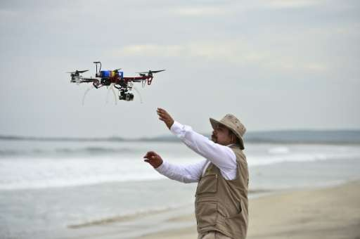 A drone is launched to keep watch over the nests of sea turtles on Morro Ayuta Beach, Oaxaca State, Mexico, on September 10, 201